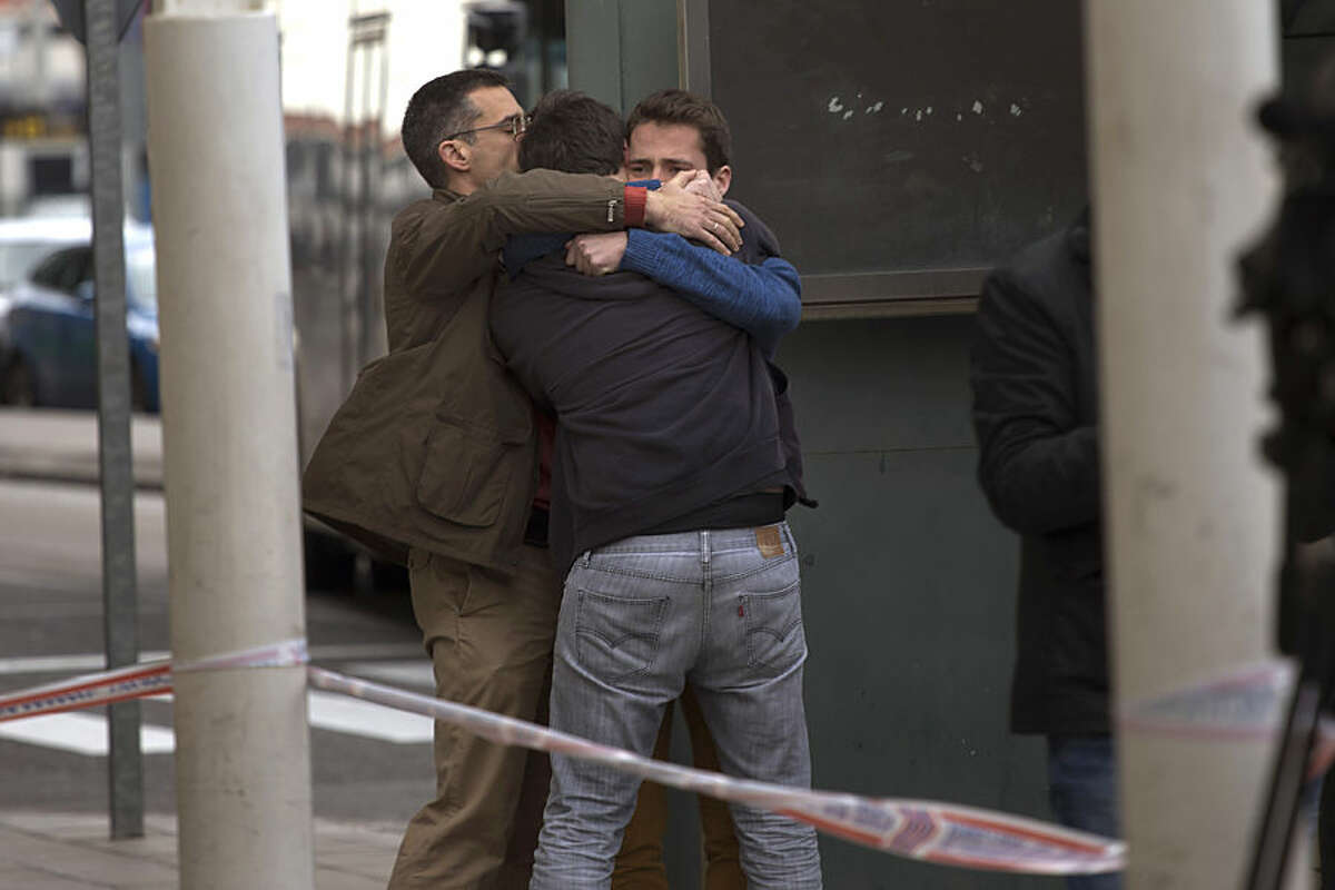 Family members of people involved in a crashed plane comfort each other as they arrive at the Barcelona airport in Spain, Tuesday, March 24, 2015. A Germanwings passenger jet carrying more than 140 people crashed in the French Alps region as it traveled from Barcelona to Duesseldorf in Germany. (AP Photo/Emilio Morenatti)