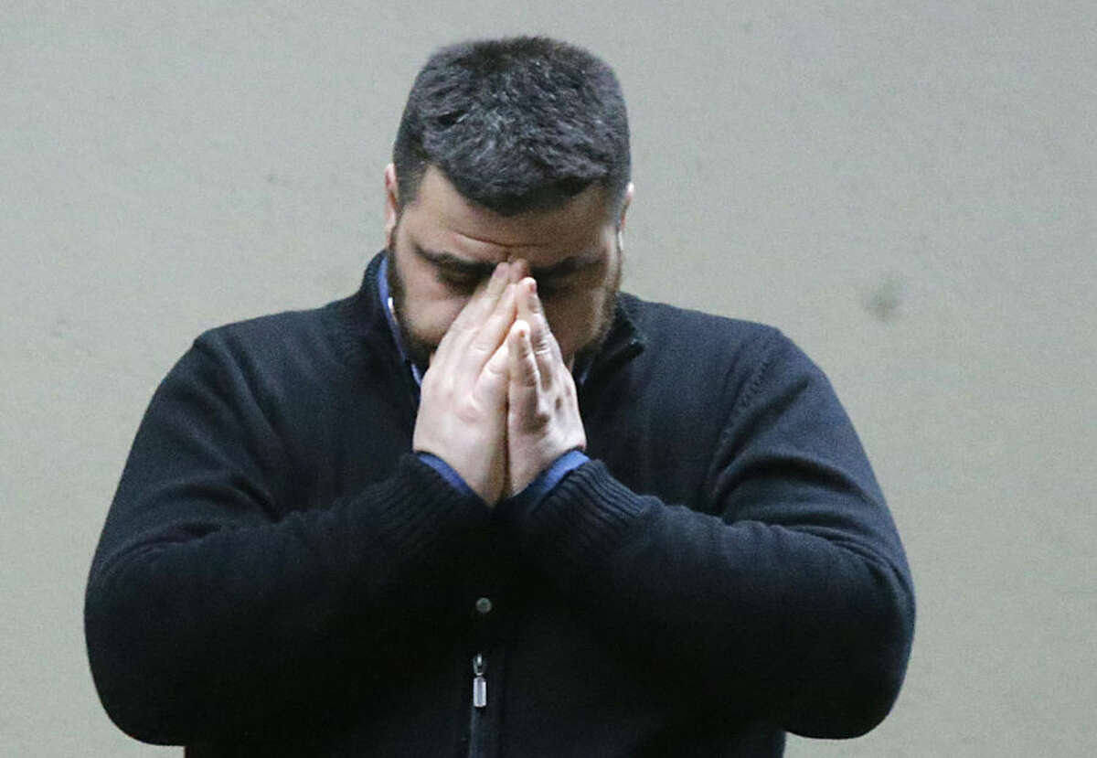 A man who appears to have waited for the missing flight 4U 9525 covers his face at the airport in Duesseldorf, Germany, Tuesday, March 24, 2015, after a Germanwings passenger jet carrying more 140 people crashed in the French Alps region as it traveled from Barcelona to Duesseldorf. (AP Photo/Frank Augstein)