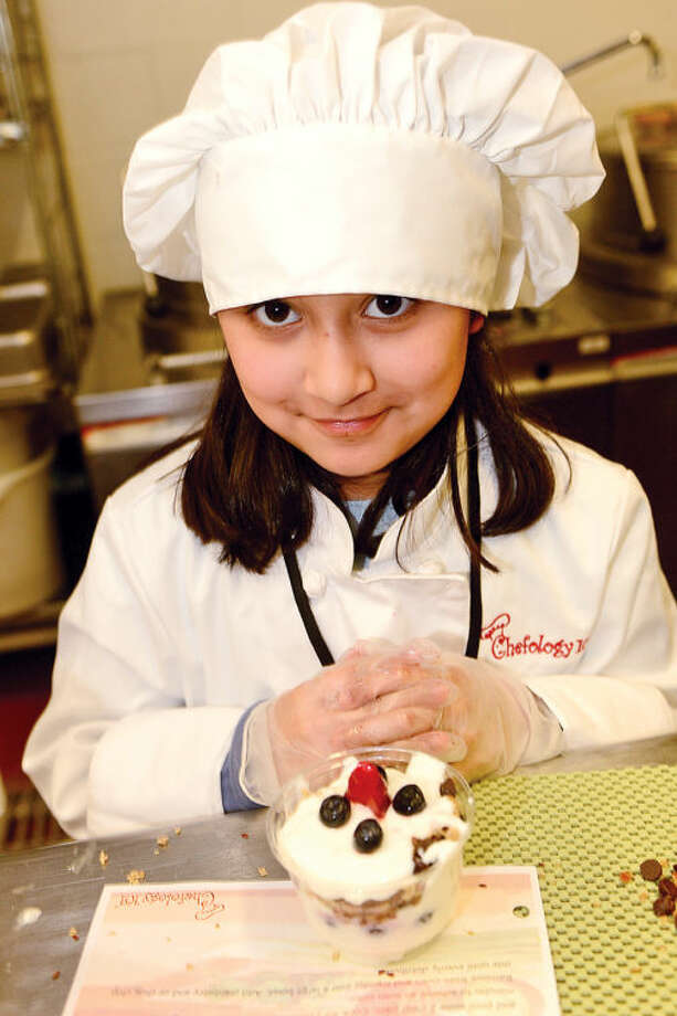 Hour photo / Erik Trautmann 9 year old Brookside student Sophia Blanco participates in the Whitsons School Nutrition and Norwalk Public School's Chefology 101 student culinary program Thursday at Central Kitchen.
