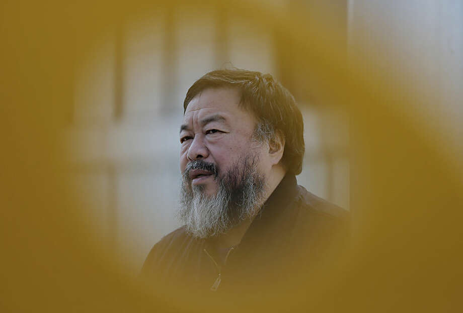 Chinese dissident artist Ai Weiwei speaks during an interview near a playground outside a shopping mall in Beijing Tuesday, March 24, 2015. Amnesty International awarded its top honor Tuesday to Ai Weiwei, who has spent years shining light on his country's restrictive political atmosphere, and to U.S. folk singer Joan Baez for her civil rights activism. (AP Photo/Andy Wong)