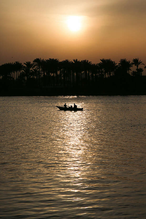 Fishermen row their boat at sunset in the Nile River in Cairo, Egypt, Tuesday, March 24, 2015. (AP Photo/Mosa'ab Elshamy)