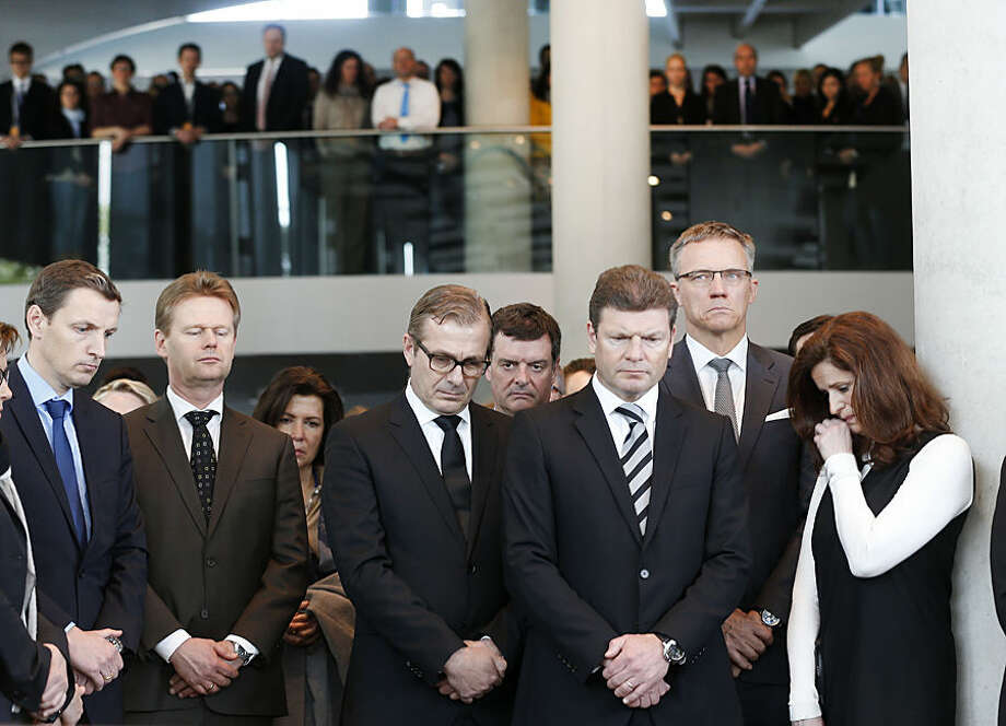 Lufthansa employees pay a minute of silence in Frankfurt, Germany, Wednesday, March 25, 2015, for the 150 victims who died in the Germanwings plane crash in the French alps on the way from Barcelona to Duesseldorf on Tuesday. (AP Photo/Michael Probst)