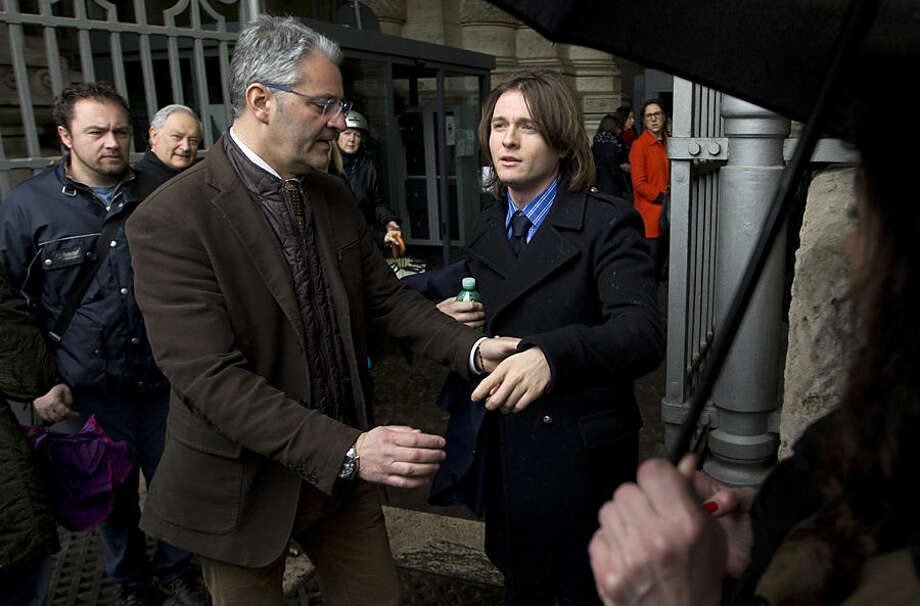 Amanda Knox's Italian ex-boyfriend Raffaele Sollecito, right, arrives at Italy's highest court building, in Rome, Wednesday, March 25, 2015. American Amanda Knox and her Italian ex-boyfriend expect to learn their fate Wednesday when Italy's highest court hears their appeal of their guilty verdicts in the brutal 2007 murder of Knox's British roommate. Several outcomes are possible, including confirmation of the verdicts, a new appeals round, or even a ruling that amounts to an acquittal in the sensational case that has captivated audiences on both sides of the Atlantic. (AP Photo/Alessandra Tarantino)