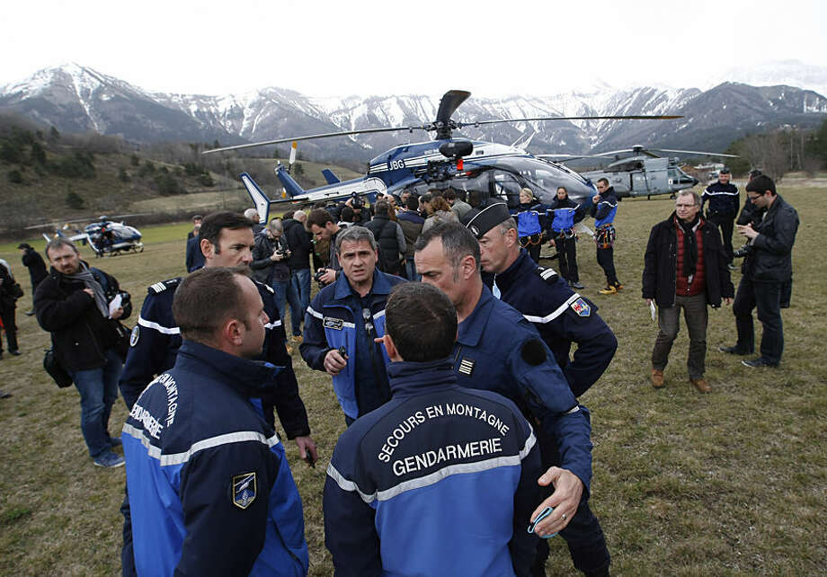 Rescue workers and gendarme gather in Seyne-les-Alpes, French Alps, Tuesday, March 24, 2015, as search-and-rescue teams struggle to reach the remote crash site of Germanwings passenger plane. A Germanwings passenger jet carrying 150 people crashed Tuesday in the French Alps as it flew from Spain's Barcelona airport to Duesseldorf in Germany, authorities said.(AP Photo/Claude Paris)