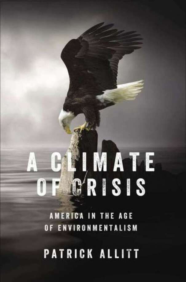 """This book cover image released by The Penguin Press shows """"A Climate of Crisis: America in the Age of Environmentalism."""" by Patrick Allitt. (AP Photo/The Penguin Press)"""
