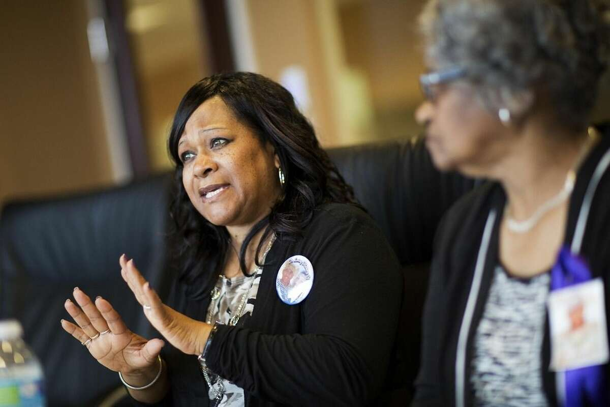 Carolyn Baylor Giummo, left, the mother of Anthony Hill, a naked, mentally ill man who was fatally shot by a police officer, speaks during an interview with Hill's grandmother Theola Baylor, right, Wednesday, March 25, 2015, in Atlanta. An attorney for Hill's family, Christopher Chestnut, says witness statements suggest DeKalb County police officer Robert Olsen could have retreated before fatally shooting Hill, 26, on March 9 while responding to a call reporting a suspicious person knocking on doors and crawling naked on the ground. (AP Photo/David Goldman)