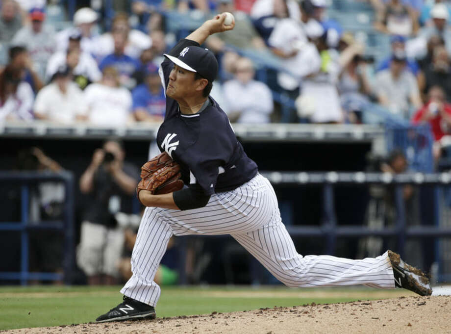 New York Yankees starting pitcher Masahiro Tanaka, of Japan, delivers in the third inning of an exhibition baseball game against the New York Mets in Tampa, Fla., Wednesday, March 25, 2015. (AP Photo/Kathy Willens)