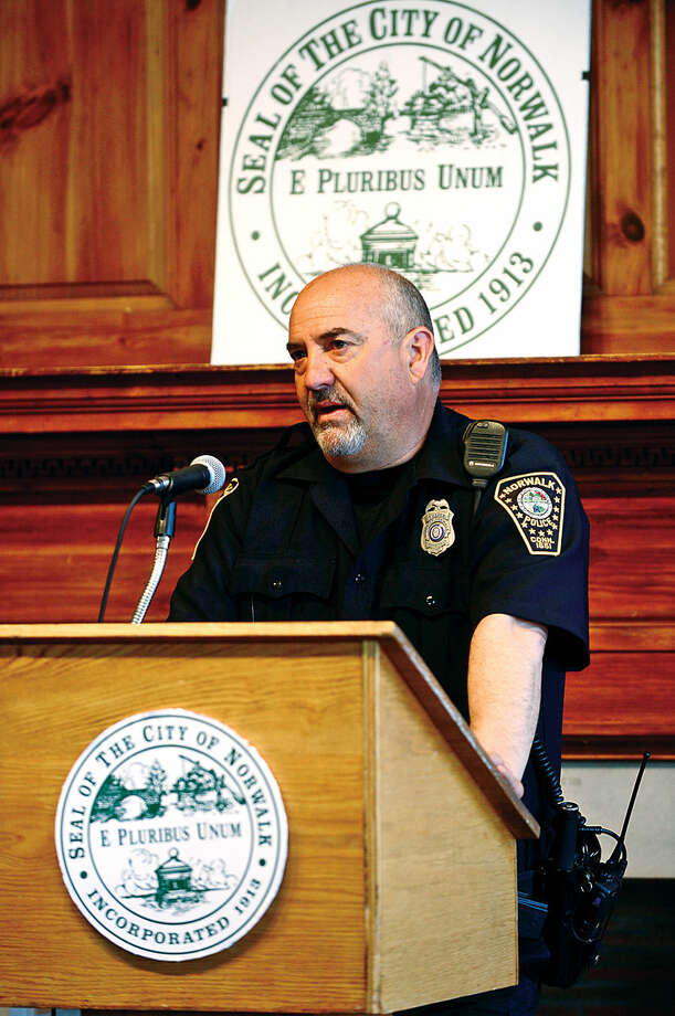 Hour photo / Erik Trautmann Norwalk police officer Russell Ouellette speaks to seniors gathered for Senior Citizens' Connection Day where seniors garnered information on cost-savings opportunitiesincluding tax relief offered Wednesday in Community Room at Norwalk City Hall.