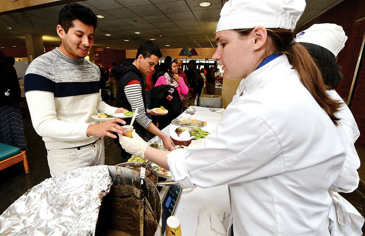 Hour photo / Erik Trautmann Norwalk Community College student Jahir Palacios recieves a healthy meal from Abilgail Frazier ant the NCC culinary program duroing the college's 11th Annual Health and Wellness Fair Wednesday in the East Campus. Representatives from area hospitals, agencies, clinics and individual practices as well as several related NCC student clubs and organizations participated.