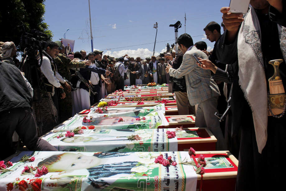 Houthi Shiite mourners attend the funeral procession of victims who were killed last week from triple suicide bombing attacks that hit a pair of mosques in Sanaa, Yemen, Wednesday, March 25, 2015. (AP Photo/Hani Mohammed)