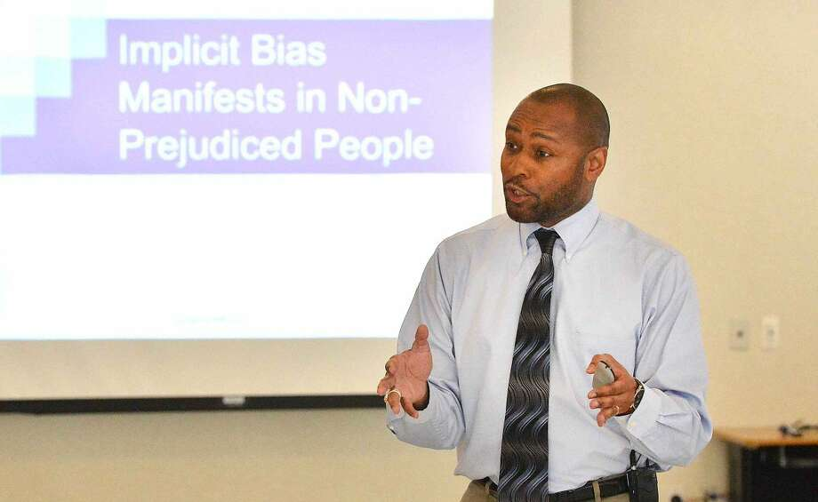 Hour Photo/Alex von Kleydorff Former Police Chief of Madison Wi. ( Retired) Noble Wray speaks during a traning session on Fair and Impartial Policing with officers from the area at the Norwalk Police headquarters