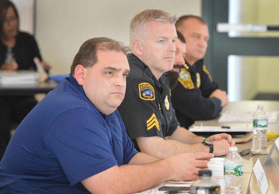 Hour Photo/Alex von Kleydorff Norwalk Police Officers, including Chief Tom Kulhawik take part in a traning session on Fair and Impartial Policing along with officers from the surrounding area at the Norwalk Police headquarters