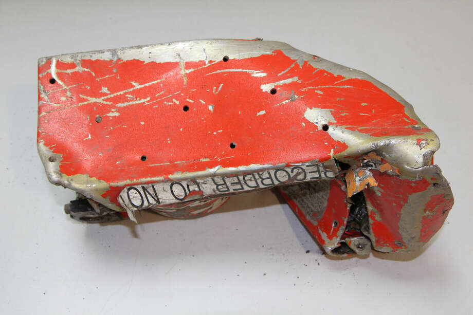 This photo provided in Paris, Wednesday, March 25, 2015 by the BEA, the French Air Accident Investigation Agency, shows part of the voice data recorder of the Germanwings jetliner that crashed Tuesday in the French Alps. French investigators cracked open the badly damaged black box of a German jetliner on Wednesday and sealed off the rugged Alpine crash site where 150 people died when their plane on a flight from Barcelona, Spain to Duesseldorf slammed into a mountain. (AP Photo/Bureau d'Enquetes et d'Analyses)