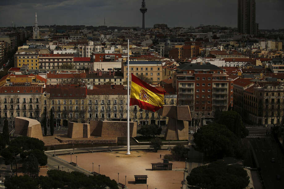 A Spanish flag flies at half staff, for the victims of the Germanwings passenger jet, in Madrid, Spain, Wednesday, March 25, 2015. The plane carrying 150 people crashed Tuesday in the French Alps region as it traveled from Barcelona to Duesseldorf in Germany. (AP Photo/Andres Kudacki)