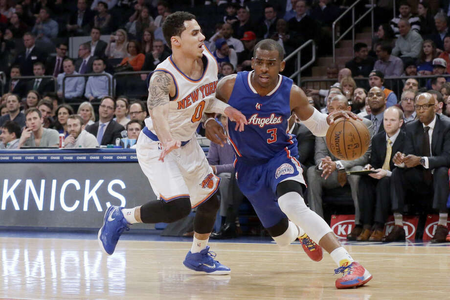 Los Angeles Clippers guard Chris Paul (3) drives to the basket against New York Knicks guard Shane Larkin (0) during the first half of an NBA basketball game, Wednesday, March 25, 2015, at Madison Square Garden in New York. (AP Photo/Mary Altaffer)