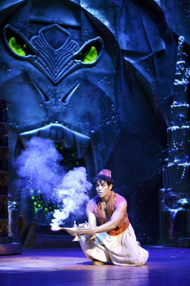 """This undated image released by Disney Theatrical Productions shows Adam Jacobs during a production of the musical """"Aladdin."""" (AP Photo/Disney Theatrical Productions, Deen van Meer)"""