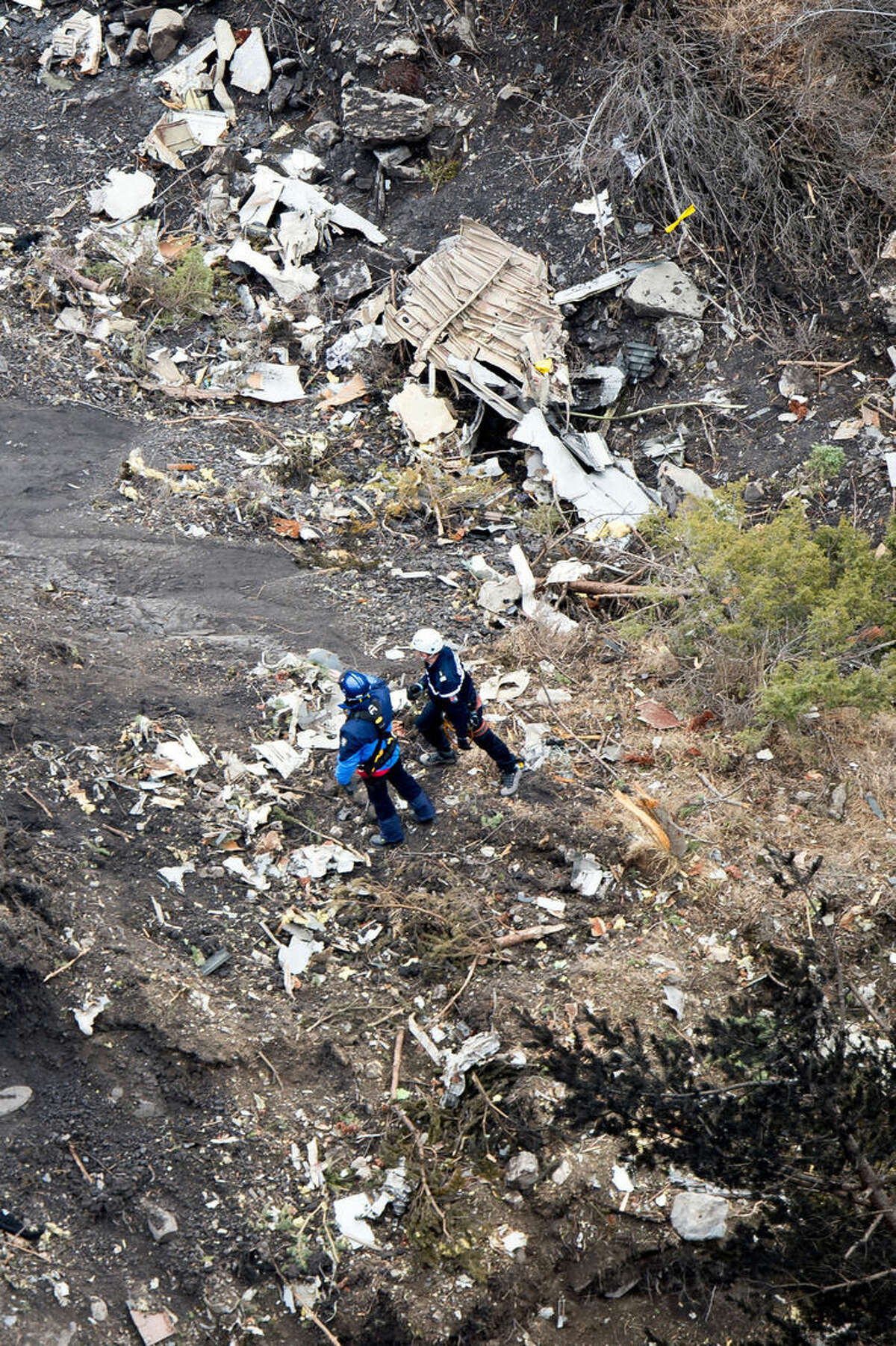 This photo provided by the Gendarmerie Nationale shows rescue workers investigating on the crash site near Seyne-les-Alpes, French Alps, Wednesday, March 25, 2015. French investigators cracked open the badly damaged black box of the Germanwings plane on Wednesday and sealed off the rugged Alpine crash site where 150 people died when their plane on a flight from Barcelona, Spain to Duesseldorf, Germany, slammed into a mountain. (AP Photo/Fabrice Balsamo, Gendarmerie Nationale)