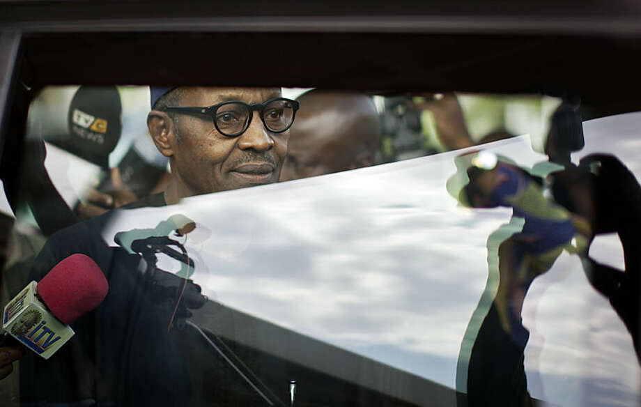 "Nigerian opposition candidate Gen. Muhammadu Buhari is photographed as he walks to his vehicle after signing a joint renewal with President Goodluck Jonathan of their pledge to hold peaceful ""free, fair, and credible"" elections, at a hotel in the capital Abuja, Nigeria Thursday, March 26, 2015. Nigerians are due to go to the polls to vote in presidential elections on Saturday. (AP Photo/Ben Curtis)"