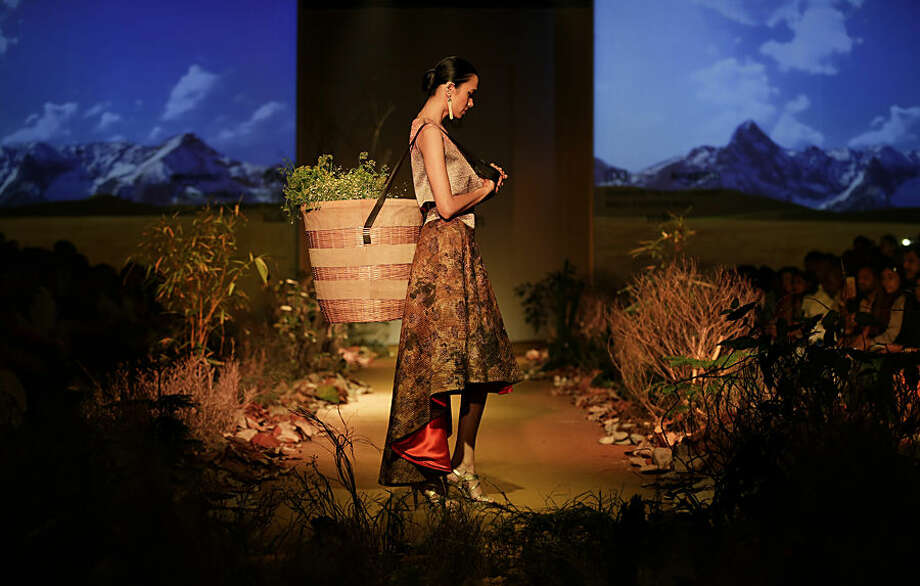 A model displays a creation by Samant Chauhan during the Amazon India Fashion Week in New Delhi, India, Thursday, March 26, 2015. The five day event runs till Sunday. (AP Photo/Altaf Qadri)