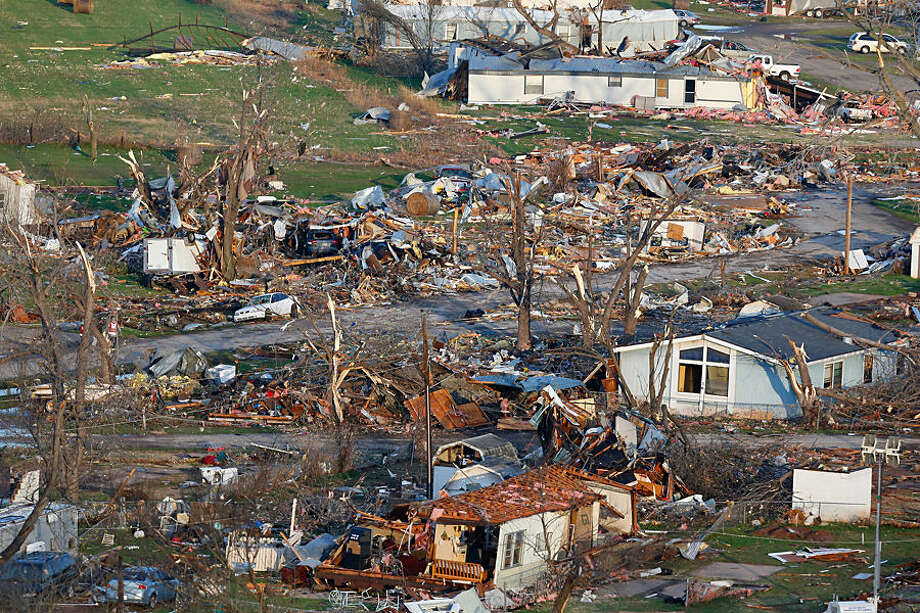 This aerial photo shows storm damage of the River Oaks Mobile Home Park in Sand Springs, Okla., on Thursday, March 26, 2015. The first batch of severe weather in this year's tornado season devastated the mobile home park, as storms across the area damaged buildings, tore off roofs and left debris strewn across roads. (AP Photo/Tulsa World, Tom Gilbert) KOTV OUT; KJRH OUT; KTUL OUT; KOKI OUT; KQCW OUT; KDOR OUT; TULSA OUT