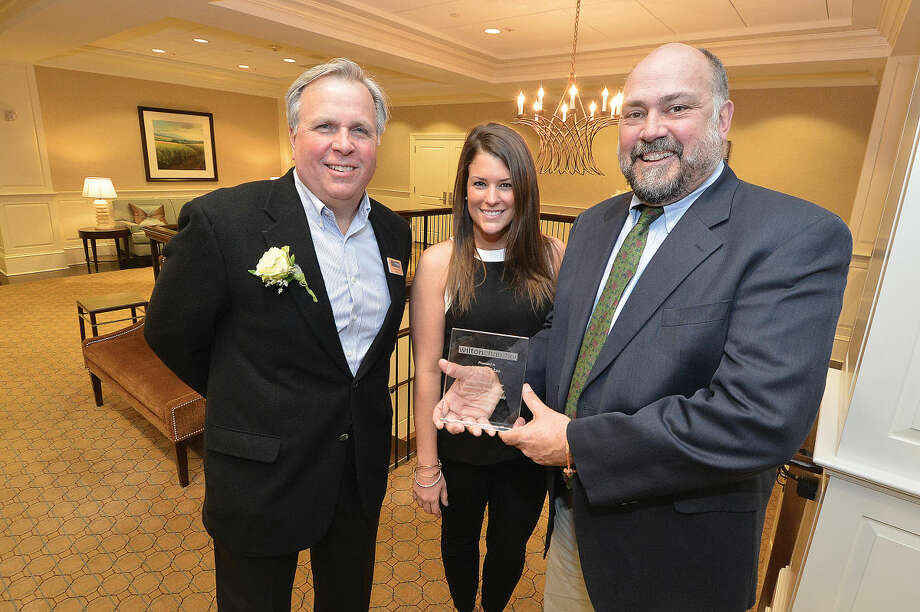 Wilton Chamber of Commerce President Patrick Russo, and Executive Director Janeen Leppert present Nicholas Lee, owner of Lee Horticultural Services, Business Person of the Year award during the chambers annual event at Rolling Hills Counrty Club.