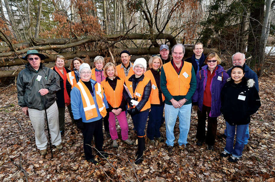 Hour photo / Erik Trautmann The tour group at the White Barn Easement at 440 Newtown Ave. as the Norwalk Land Trust hosts a tour of all of its properties Saturday morning.