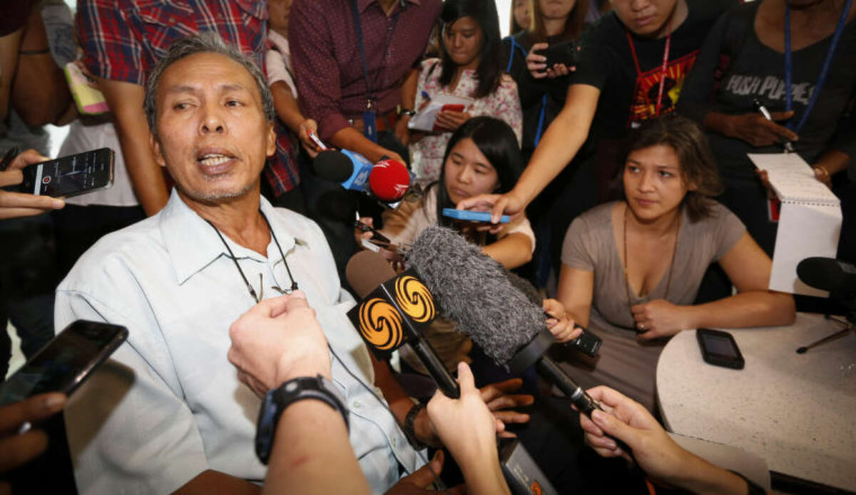 Selamat Omar, 60, father of one of the passengers aboard a missing Malaysia Airlines plane, speaks to the media at a hotel in Putrajaya, Malaysia, Thursday, March 20, 2014. Four military search planes were dispatched Thursday to try to determine whether two large objects bobbing in a remote part of the Indian Ocean were part of a possible debris field of the missing Malaysia Airlines flight. One of the objects spotted by satellite imagery had a dimension of 24 meters (almost 80 feet) and the other one was smaller. (AP Photo/Vincent Thian)