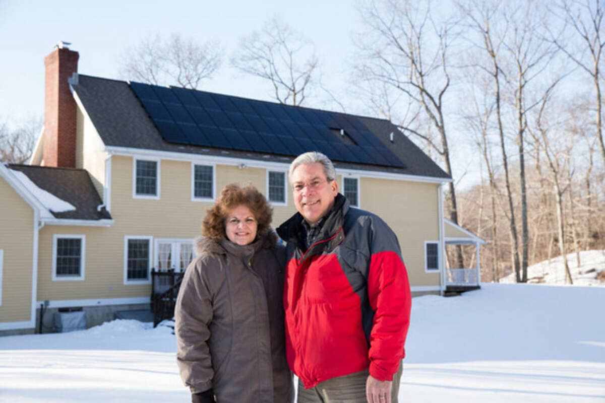 Contributed photo RosAnne and Richard Hubli outside their recently solar-paneled Wilton home.