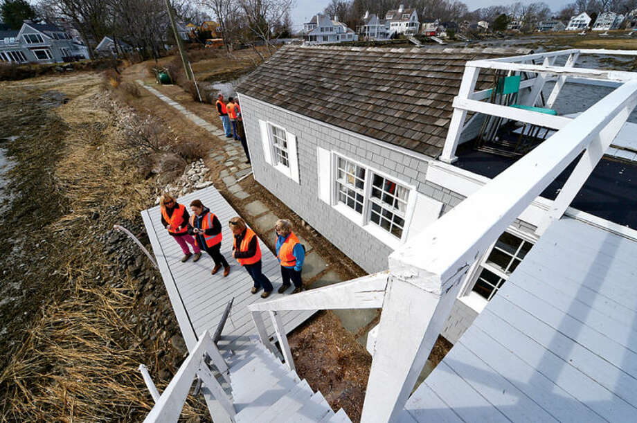 Hour photo / Erik Trautmann The tour group hikes to view Old Trolly peninsula at 2 Nearwater Lane as the Norwalk Land Trust hosts a tour of all of its properties Saturday morning.