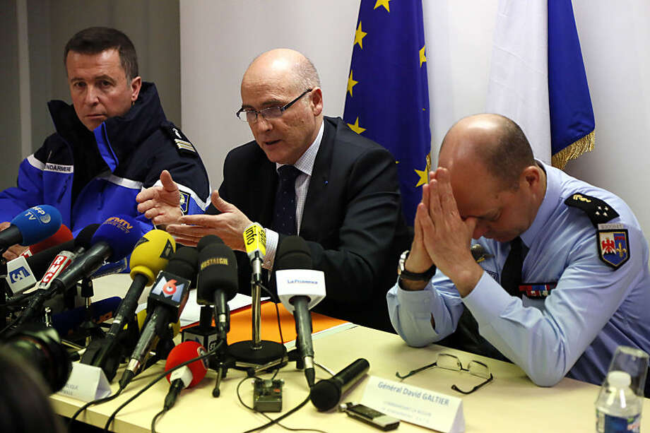 """Marseille prosecutor Brice Robin, center, with Gen. David Galtier, right,holds a press conference in Marseille, southern France, Thursday March 26, 2015. Robin said the co-pilot was alone at the controls of the Germanwings flight that slammed into an Alpine mountainside and """"intentionally"""" sent the plane into the doomed descent, killing 150 people. (AP Photo)"""