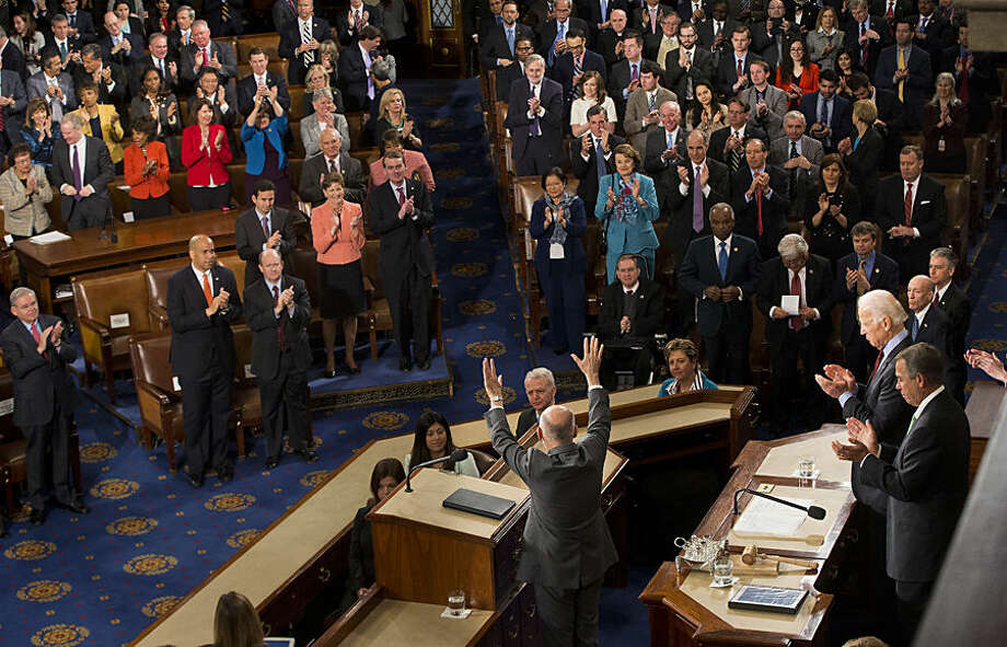 Afghanistan's President Ashraf Ghani, center, waves at the conclusion of his speech to a joint meeting of Congress on Capitol Hill in Washington, Wednesday, March 25, 2015. (AP Photo/Pablo Martinez Monsivais)