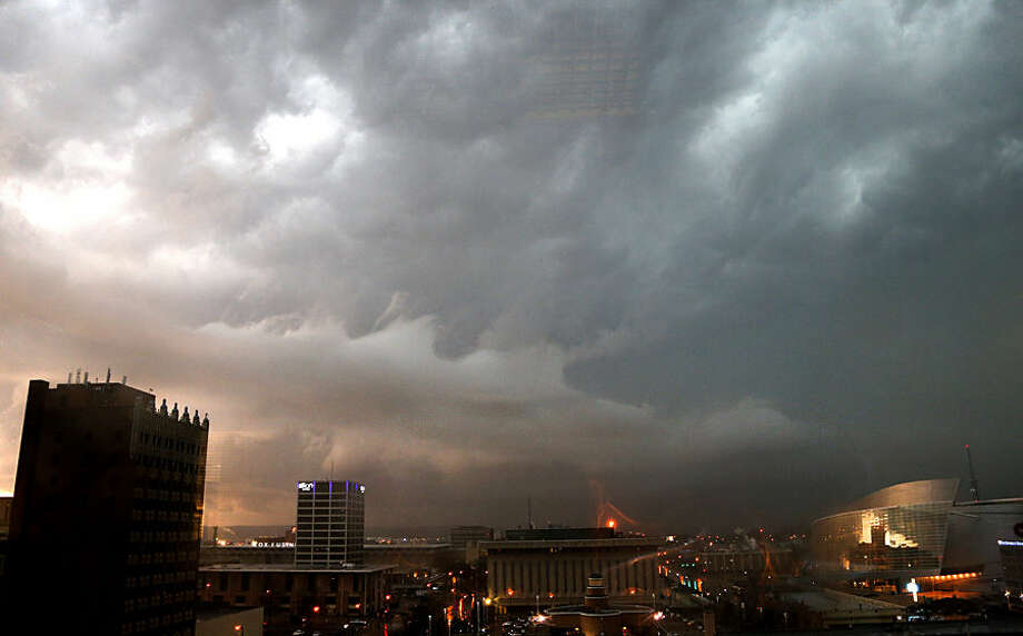 Storm clouds gather over downtown Tulsa, Okla., Wednesday March 25, 2015. The slow start to the nation's tornado season came to a blustery end Wednesday when tornadoes hit Arkansas and Oklahoma, including one that raked Tulsa and its suburbs during the evening rush hour. (AP Photo/Tulsa World, Christopher Smith) KOTV OUT; KJRH OUT; KTUL OUT; KOKI OUT; KQCW OUT; KDOR OUT; TULSA OUT