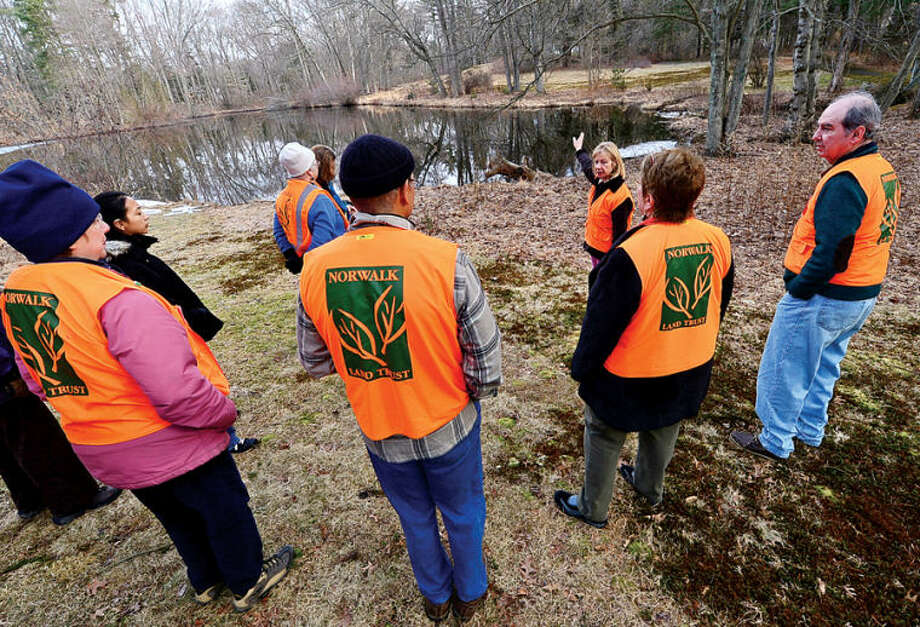 Hour photo / Erik Trautmann JoAnne Jackson leads a walk at the White Barn Easement at 440 Newtown Ave. as the Norwalk Land Trust hosts a tour of all of its properties Saturday morning.