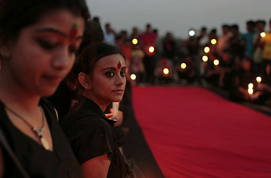 Bangladeshi social activists participate in a rally in remembrance of those who were killed on the night of March 25, 1971, a day ahead of the country's declaration of independence from Pakistan, in Dhaka, Bangladesh, Wednesday, March 25, 2015. (AP Photo/ A.M. Ahad)