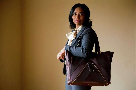 In this Wednesday, Feb. 24, 2016, photo, Sherrill Mosee, founder of MinkeeBlue, poses for a photograph with her product, the Madison Tote Bag, in Philadelphia. Getting a product on QVC is a small business owner's dream. One of Mosee's totes is selling on QVC.com. (AP Photo/Matt Rourke)