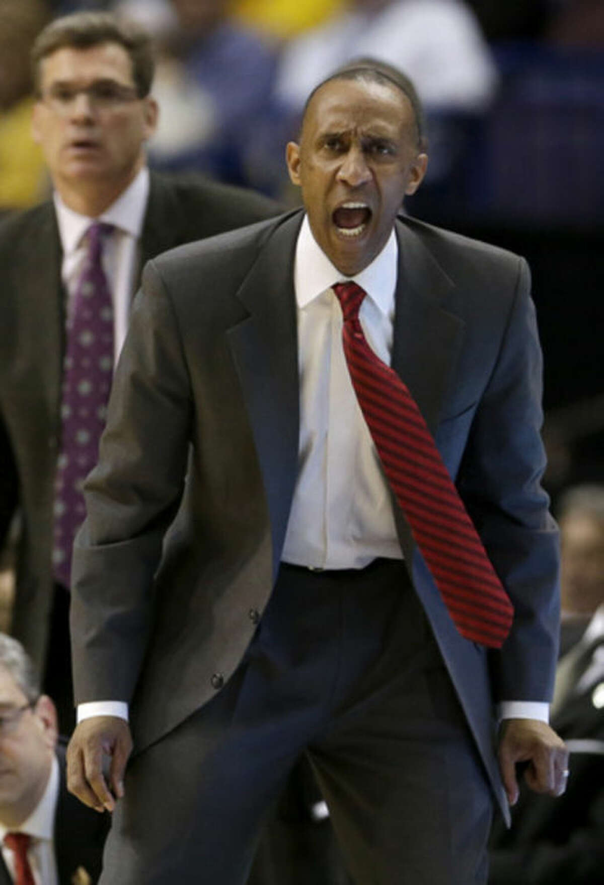 Stanford head coach Johnny Dawkins yells to his players during the second half of a second-round game in the NCAA college basketball tournament, Friday, March 21, 2014, in St. Louis. Stanford won the game 58-53. (AP Photo/Charlie Riedel)