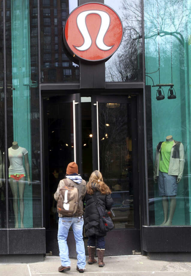 FILE - In this March 19, 2013 file photo, shoppers enter a Lululemon Athletica store in New York. Lululemon made a name for itself with its pricey brand of yoga gear in the early aughts, but in 2013 that name was shattered after a product defect caused yoga pants so sheer they could be see-through. Founder and chairman Chip Wilson compounded the error by suggesting in a television interview that fat thighs caused some yoga pants to be too sheer. (AP Photo/Mary Altaffer, File)