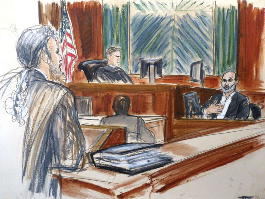 """In this courtroom sketch, Osama bin Laden's son-in-law Sulaiman Abu Ghaith, right, testifies at his trial Wednesday, March 19, 2014, in New York, on charges he conspired to kill Americans and aid al-Qaida as a spokesman for the terrorist group. Listening to testimony are Judge Lewis Kaplan, center, and defense attorney Stanley Cohen, at podium. In his surprise testimony, Abu Ghaith recounted the night of the Sept. 11, 2001, attacks, when the al-Qaida leader sent a messenger to drive him into a mountainous area for a meeting inside a cave in Afghanistan. """"Did you learn what happened? We are the ones who did it,"""" Abu Ghaith, recalled bin Laden telling him. (AP Photo/Elizabeth Williams)"""