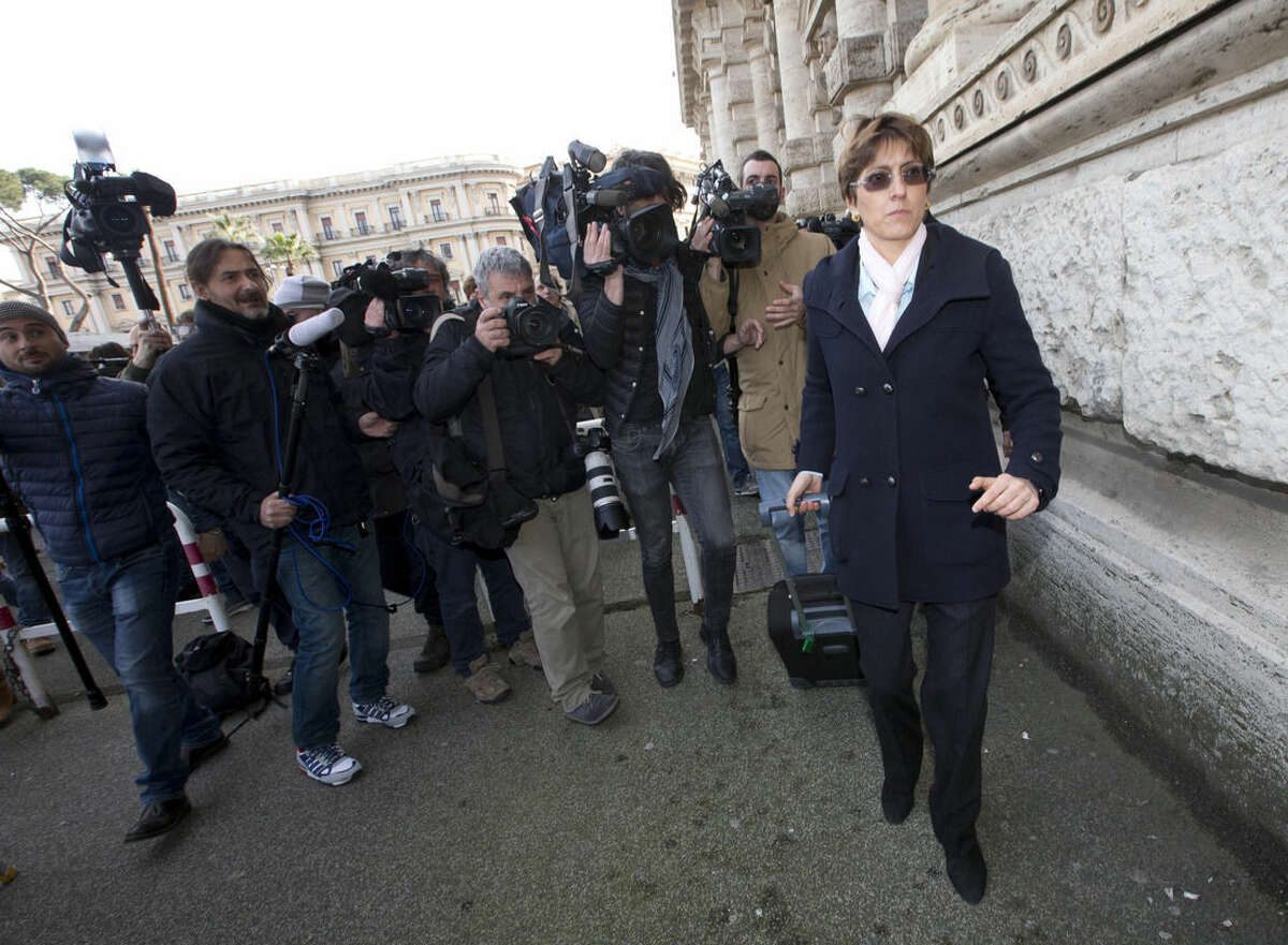 Raffaele Sollecito's lawyer Giulia Bongiorno, right, arrives at Italy's highest court building, in Rome, Friday, March 27, 2015. American Amanda Knox and her Italian ex-boyfriend expect to learn their fate Friday when Italy's highest court hears their appeal of their guilty verdicts in the brutal 2007 murder of Knox's British roommate. Several outcomes are possible, including confirmation of the verdicts, a new appeals round, or even a ruling that amounts to an acquittal in the sensational case that has captivated audiences on both sides of the Atlantic. (AP Photo/Alessandra Tarantino )