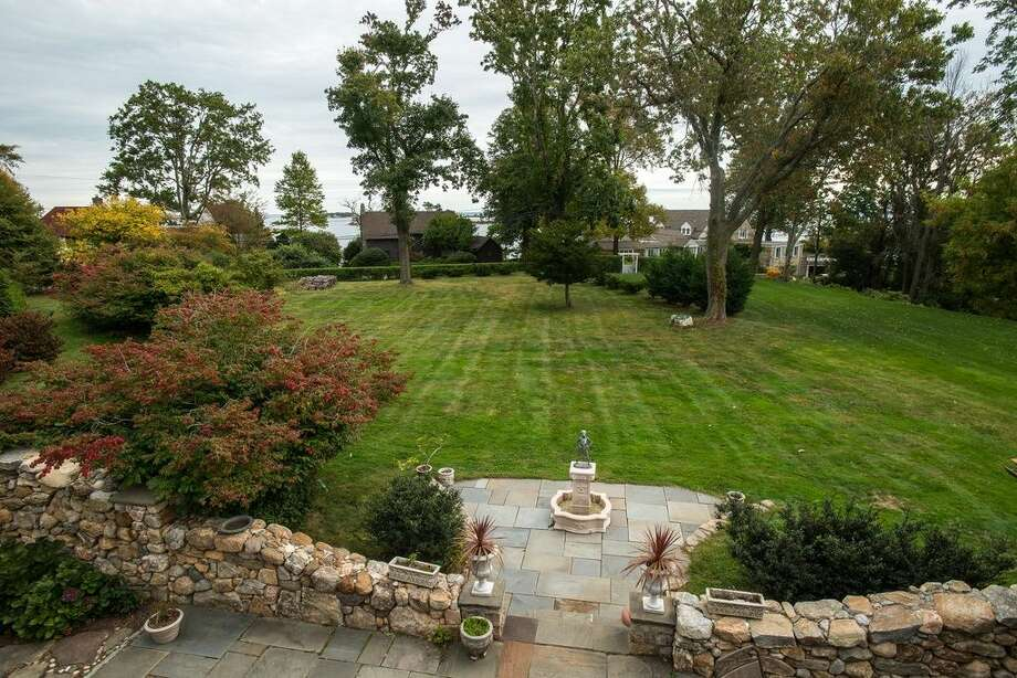 16 Point Rd, Norwalk, CT 068545 beds 4 baths 2,798 sqftFeatures: Wet bar, stone patio with covered dining area and water fountain, private beach, tennis courts, dock(Credit: Zillow)
