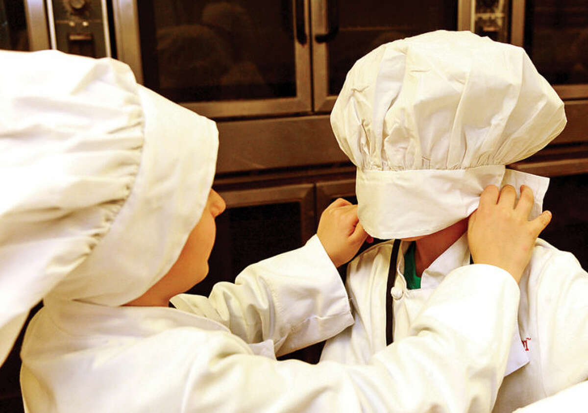 Hour photo / Erik Trautmann Elementary school students take part in Whitsons School Nutrition and Norwalk Public School's Chefology 101 student culinary program Thursday at Central Kitchen.