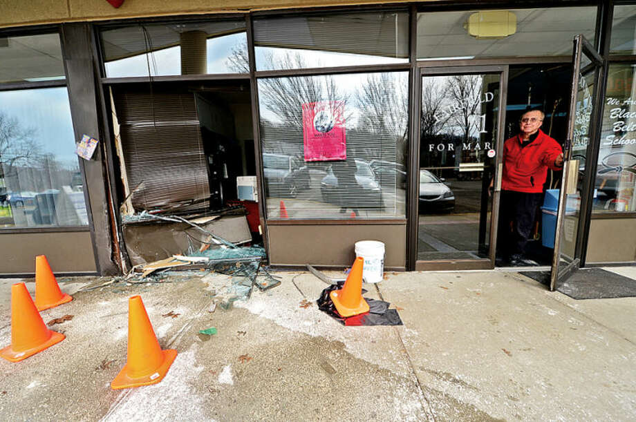 Hour photo / Erik Trautmann Master Spyros Theodorides  of Karate Universe accidentally drove his vehicle through the front of his dojo at 666 Main Ave. Saturday.