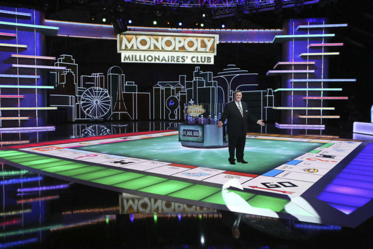 In this undated photo provided by Monopoly Millionaires' Club, Bill Gardell hosts the exciting new gameshow