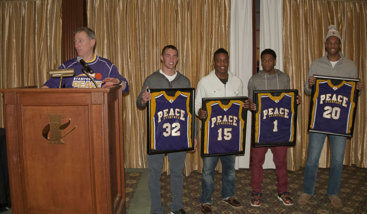 Brian Kriftcher presents Stamford Peace's Kyle A. Markes Humanitarian Award to, from left: Ryan Kriftcher, Tyrell St. John, Jeremiah Livingston, and Kweshon Askew.