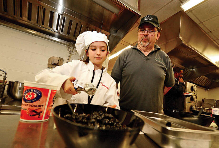 Hour photo / Erik TrautmannElementary school students take part in Whitsons School Nutrition and Norwalk Public School's Chefology 101 student culinary program Thursday at Central Kitchen.