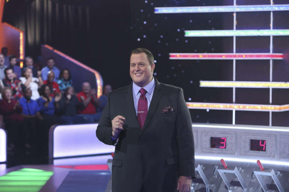 "In this undated photo provided by Monopoly Millionaires' Club, Bill Gardell hosts the new game show ""Monopoly Millionaires' Club"" where contestants play for a chance to win up to $1 million. The show debuts the weekend of March 28-29, 2015. (AP Photo/Monopoly Millionaires' Club, Steve Reed)"