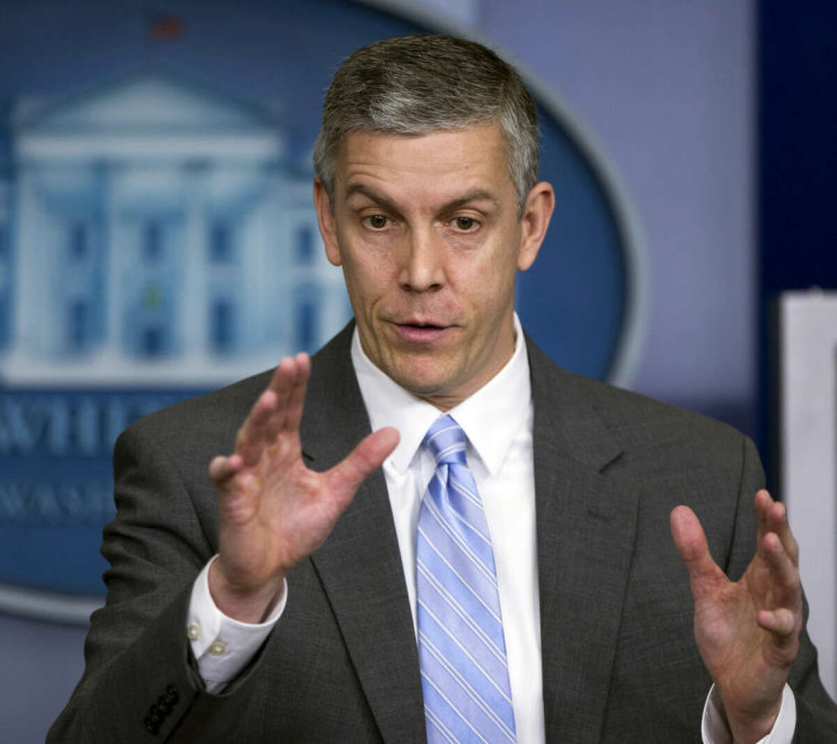 ** HOLD FOR RELEASE UNTIL 12:01 A.M. EDT ON FRIDAY, MARCH 21, 2014 ** FILE - In this March 14, 2014, file photo, Education Secretary Arne Duncan speaks to reporters during briefing in the Brady Press Briefing Room of the White House in Washington. Even preschoolers are getting suspended from U.S. public schools, and they're disproportionately black, a trend that continues up through the later grades. Data to be released Friday, March 21, 2014, by the Education Department's civil rights arm finds that black children represent about 18 percent of children enrolled in preschool programs in schools, but almost half of the students suspended more than once. Six percent of the nation's districts with preschools reported suspending at least one preschool child.