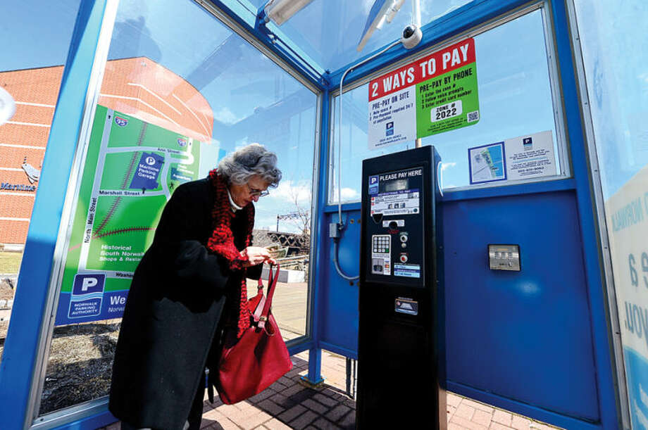 Hour photo / Erik Trautmann Rhodas Adler pays for her parking at the IMAX lot at the Maritime Aquarium Friday afternoon. The SoNo Task Force, a panel formed by Mayor Harry W. Rilling in December, looks to ease parking for customers and merchants. The Ordinance Committee is exploring installing Redevelopment Agency liaison on Norwalk Parking Authority to help.