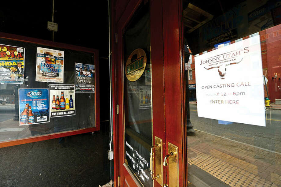 Hour photo / Erik Trautmann The Black Bear Saloon at 80 Washington St. in South Norwalk is closed and will reemerge as Johnny Utah's, a country bar and grill. Some businesses are finding hard to keep their doors open while others look to reinvent themselves.