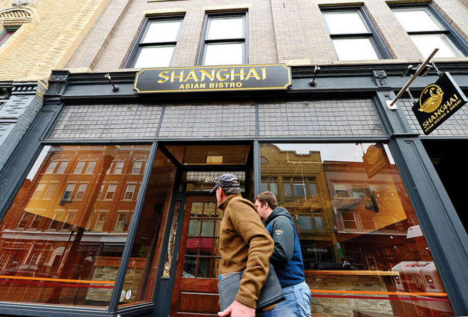 Hour photo / Erik Trautmann Shanghai Asian Bistro at 124 Washington St in SoNo is closed. Some businesses are finding hard to keep their doors open while others look to reinvent themselves.